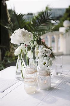 Simple florals in mix and matched vases for table decor. Captured By: Raw Photography http://www.weddingchicks.com/2014/05/16/get-married-in-croatia/
