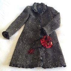 """GORGEOUS ❤️DKNY❤️ruffle coat - Sz 2 Absolutely gorgeous DKNY ruffle coat in size 2! Black, gray and white tweed will match any outfit. Perfect topper over a cocktail dress. Has 2 deep pockets in front. This is a weighty coat that will keep you warm. Photos do not do it justice! Absolutely stunning in person. 36"""" long, 17"""" armpit to armpit. DKNY Jackets & Coats Pea Coats"""