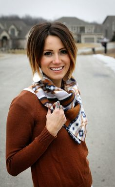 Try this ten minute tutorial, only with different fabric and a trim to finish it so... 20 min scarf