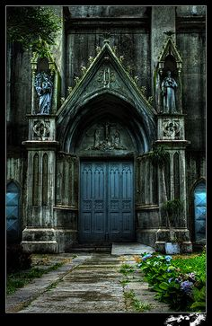 Old stone church with blue doors...