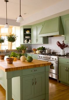 Visually rich and warm to the touch, natural wood kitchen counters are making a comeback. Get ideas for your island or kitchen renovation in this wood countertops guide. Discover what type of wood and style will work best in your home at This Old House. Green Kitchen Cabinets, Refacing Kitchen Cabinets, Kitchen Colors, Kitchen Layout, Kitchen Design, White Cabinets, Green Kitchen Countertops, Kitchen Walls, Kitchen Island