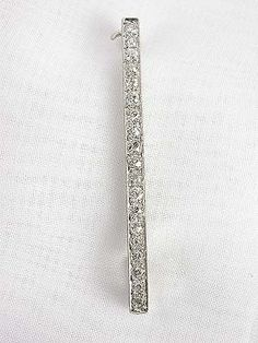 Edwardian Antique Diamond Brooch , PN-1974, Constructed of platinum on 18k white gold, this Edwardian antique brooch can be worn either vertically or horizontally. Nineteen old European cut diamonds accent this antique brooch for a total diamond weight of 0.86 carats. Circa 1900