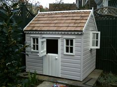 Painted childrens cottage with opening window