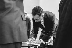 Signing those licenses Shot by Emmanuel Abreu for @5thavedigital  #eabreuweddings #weddingday #wedding