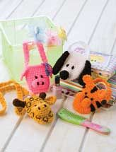 """Animal Pocket Pouches    This menagerie of little critters creates a variety of fun totes that kids will love using to carry their cellphones, music players or other take-along items. Four designs include a tiger, puppy, pig and giraffe. This e-pattern was originally published in Easy Living Crochet.  Size: 3 1/2"""" x 4"""", excluding handle. Made with medium (worsted) weight yarn and size G (4mm) hook.  Skill Level: Intermediate  Download Size: 5 page(s)  PRICE $3.49"""