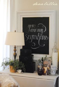 Dear Lillie: frame makeover with chalkboard paint...she always has the most beautiful vignettes