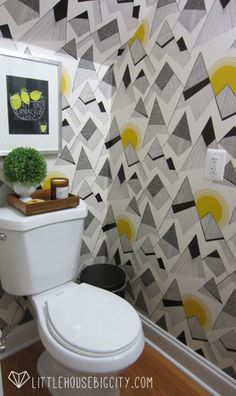 How to install wallpaper in a powder room. Bold wallpaper from MissPrint makes this half bath pop. #wallpaper #diy