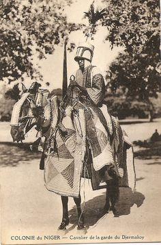 """Vintage postcard: """"Cavalier de la garde du Djermakoy"""", Niger, circa 1910. Horseman of the bodyguard of the Djermakoy, king of the Djerma people. Note the quilted armour."""