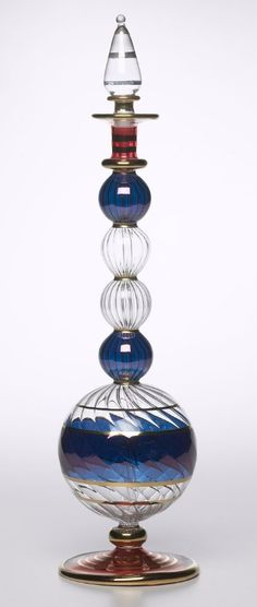 Egyptian Hand-blown Pyrex Glass Perfume Bottle: 18kt gold detailing. Magenta & blue decorative accents. Glass stopper with perfume dropper / http://www.culturalelements.com/egyptian-hand-blown-glass-perfume-bottle.html