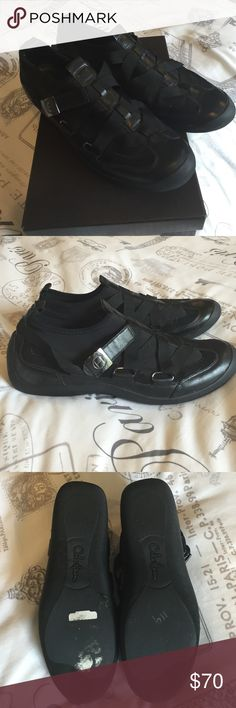 Coke Haan sneakers NWOT Cole Haan sneakers. Black leather and scuba material with cross grain ribbon adjustable straps. Gunmetal Cole Haan logo buckle. Never worn. Size 8B Original box included. Cole Haan Shoes Sneakers
