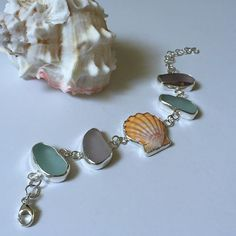 I only started this bracelet like 3 days ago... Sunrise shell, blue and purple…