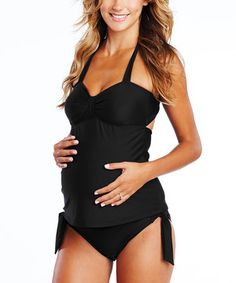 Rule the maternity boardwalk in this trendy tankini. Designed with stretch for that budding bun in the oven and boasting a bow at the back and side-tie bikini bottoms, it allows moms-to-be to sun in style through all three trimesters.