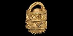 VIKING GOLD FILIGREE BUCKET PENDANT 9th-11th century AD A gold pendant with domed bottom, flat-section wall and filigree handle, ornamented with granulation and filigree detailing. 2.22 grams, 15mm