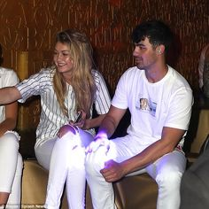Matching: Hadid and Jonas wore white, with the 20-year-old model donning a Yankees top