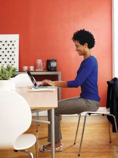 Slide your desk chair back from your desk a bit and scoot forward on the seat a few inches. Press yo... - Provided by Redbook