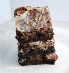 Recipe for cheesecake brownies made even more delicious with the addition of Oreos.