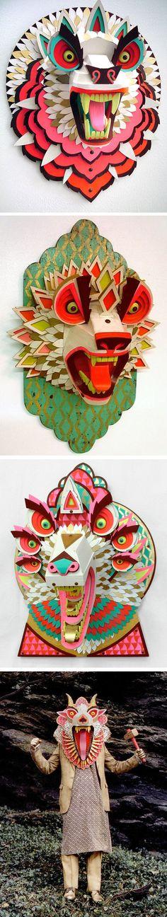 wood masks by A. J. Fosik.