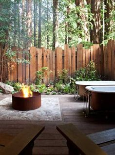 :) step outside to this amazing outdoor bathroom featuring 2 clawfoot baths and an open fire.. lye back & relax with the surrounds of nature. Lots of plants allows fresh air always while taking a bath in your antique tub. I love clawfoot baths... So dreamy
