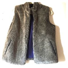 J. McLaughlin reversible faux fur vest J. McLaughlin faux fur vest size small. In great used condition. Some of the fur in the back has been a little matted down but shown in photo. Really not noticeable with wear. Reversible to purple silk side J. McLaughlin Jackets & Coats Vests