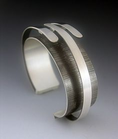 Cuff | Theresa Carson. 'Triple Arc'  Oxidized and sterling silver.