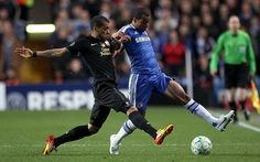 Neck and neck: Dani Alves (left) and Chelsea's Ashley Cole battle for the ball