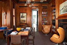 Vintage Egg chairs provide additional seating in a Boston townhouse's handsome library
