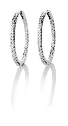 8218.  18k white gold creole earrings with brilliant cut diamonds.  $3755