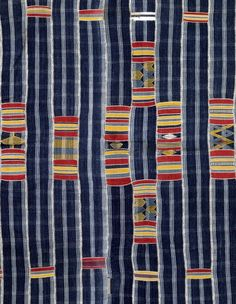 Detail from a rare men's hand spun cotton wrapper cloth from the Bondoukou area, northeast part of the Ivory Coast (ca. 1900). via Adire African Textiles