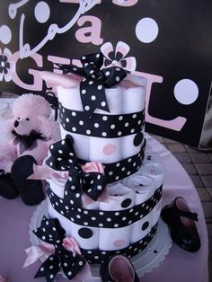I haven't seen many diaper cakes I like, but this one is way adorable!  I'm guessing those are cloth diapers though.