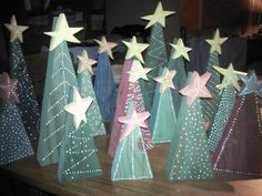 Due to the volume of orders for the Christmas season these may take a week to get to you. These trees are handmade and unique. The trees are made from found wood, painted a variety of colors, and painted with white dots. This listing is for one tree and priced by 12 inches, 10 inches or 8 inches tall. Let us pick a few for you in varying heights and colors, or check out the different designs and we can make them to order. Let us know the height, color of the tree, color of the star, and what…