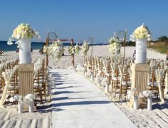 Our bride and groom shared their vows at the Naples Waldorf Astoria and the weather was video perfect. The sculptured sand, white carpet isle lined with white flowers arrangements, and the white fabric draped gold chairs were breath taking. After the excitement of the beautiful fireworks the reception continued with the elegance and perfection of their Wedding Day. Naples' Original Video Productions wishes the happy couple a lifetime of happiness.