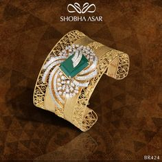 Gold, Emerald, and Diamond cuff