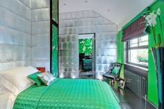 Unique wall covering brings shine to this vibrant green bedroom