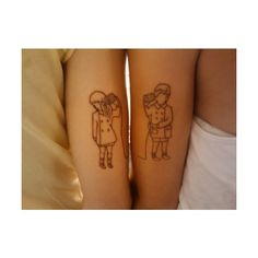 Coordinating couple tattoos with boy and girl black line tattoo playing telephone with tin cans
