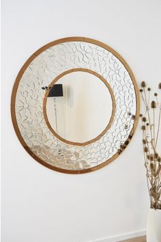 We have for sale this wonderful and very unique round bronze edged venetian mirror. This mirror has a beautiful design and is exclusive to us, the outer clear glass section has a stylish mosaic effect and is then outlined by two circles of bronze glass which gives a stunning finish.