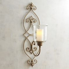 Bring a glamorous lighting scheme to your wall with our gilded sconce, crafted exclusively for Pier 1 with a hand-forged iron base and handblown, tempered-glass hurricane. Candle Chandelier, Candle Lamp, Candle Wall Sconces, Pillar Candles, Flameless Candles, Living Room Candles, Sconces Living Room, Large Candle Holders, Metal Candle Holders
