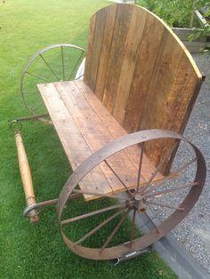 Old barn wood + old wagon wheels= masterpiece