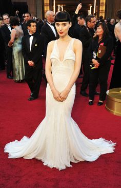 All eyes on Rooney Mara, she is wearing a structured cream gown with sheer panelling along the shoulders by her go-to Givenchy: http://www.glamour.co.za/fashion-celebrity/632353.html#