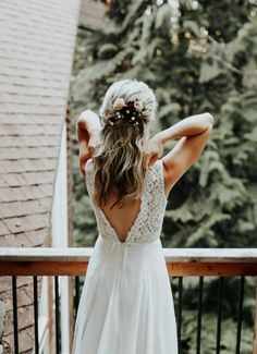 Tiny roses and seed pearls make for a beautiful half-up do without looking fussy   image by Karra Leigh Photography