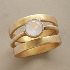 Solo Luna Rings, Set Of 3 Rings of brushed, 14kt goldplated sterling silver orbit a solo rainbow moonstone.