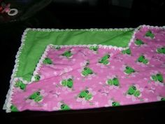 Princess frog baby blanket with crocheted edge.