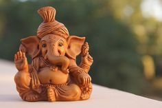 Little Ganesha statue <3 Something to keep in your purse or wallet every day to remind you and keep you grounded. :)