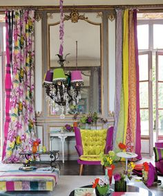 I like the chair cover in this picture, different colour at the ends and that colour has been used for buttons on the centre piece... Like this a lot!  Designers Guild of course...