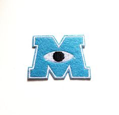 Check out this item in my Etsy shop https://www.etsy.com/hk-en/listing/241297545/monsters-university-patch-mike-wazowski