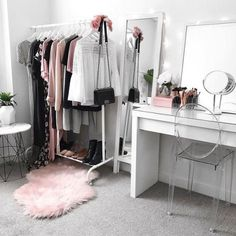My dressing room / makeup vanity / wardrobe Ikea malm dressing table, clothing rack mirror, Kmart rug side table, Target clear chair