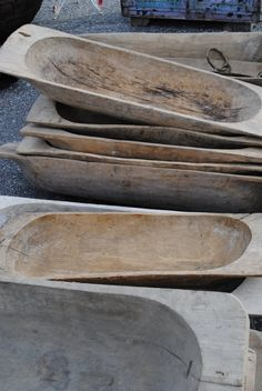 These are wooden molds used for raising bread.  While they are no longer suitable to hold anything edible, they can be cleaned up with simple oil from your pantry.... (but not too much you want them to retain that aged look)....and used around your home to hold found objects, collections and all kinds of wonderful things♥
