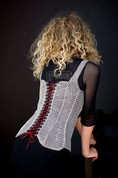 Maille Corset by ~Szyszuniec on deviantART  Very Cool!  I can totally see this being both decorative and functional if in certain point and/or stretches the rings can be soldered or fused.
