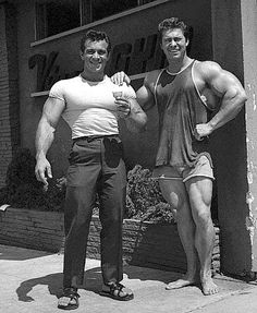 "Throwback Thursday at Ironcompany.com® - Freddy Ortiz and Larry Scott during the ""Golden Age"" of bodybuilding. Taken in front of Vince's Gym owned by the legendary Vince Gironda."