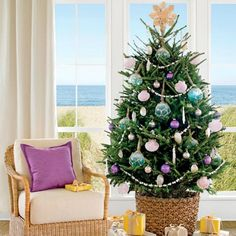 Lovely coastal Christmas tree with rope net ornaments from Coastal Living. Featured on CC: http://www.completely-coastal.com/2015/11/net-glass-float-ornaments-homemade-diy-and-where-to-buy.html