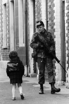 May A Belfast girl chats to a soldier out patrolling the streets in the Falls Road area. (Photo by Central Press/Getty Images) Northern Ireland Troubles, Belfast Northern Ireland, Dublin Ireland, Ireland Travel, Ireland Food, Cork Ireland, Ireland Vacation, British Soldier, British Army